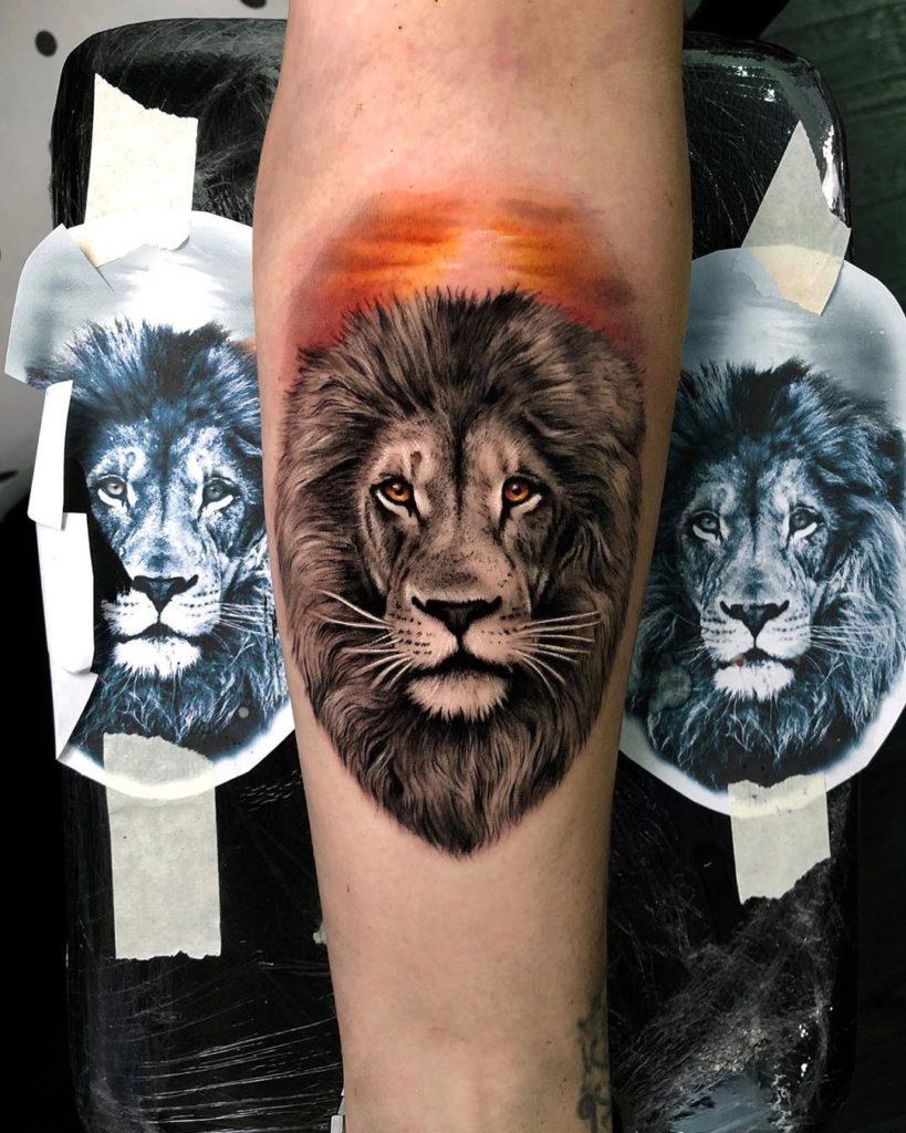 Tatuaż głowa Lwa zesłońcem naprzedramieniu Znaczenie dla mężczyzn ikobiet