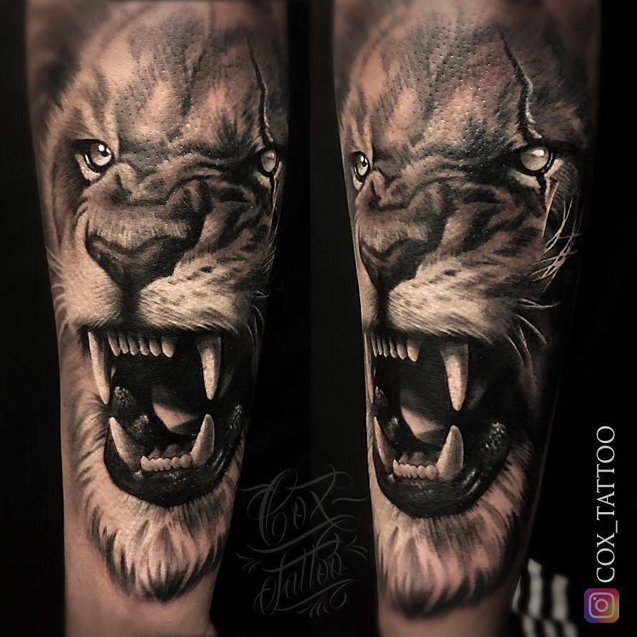 Tatuaż zły lew naprzedramieniu Znaczenie dla mężczyzn ikobiet