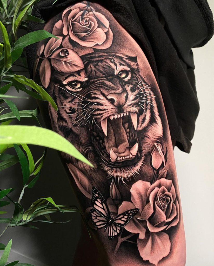 Tatuaż głowa złego tygrysa zróżami naudzie ibiodrze dla mężczyzn ikobiet